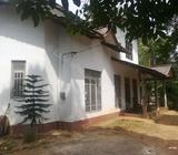 Land with two storied house for sale