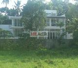 modern house bordering paddy field in pannipitiya