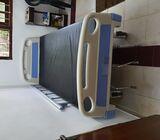 Unused three function hospital bed for sale