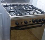 Indesit Gas stove with electric oven.